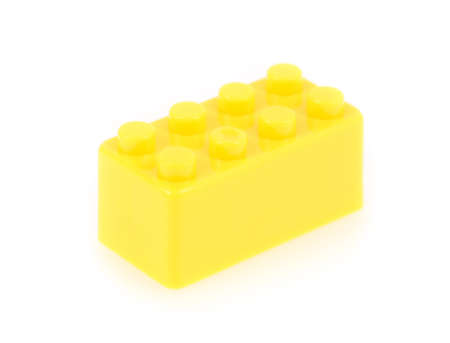 yellow lego block: building block isolated on white background