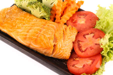 vegetable tray: Grilled salmon fillet with vegetable on on bamboo tray Stock Photo
