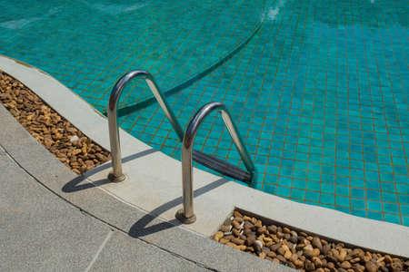 grab: Grab bars ladder in the swimming pool at hotel
