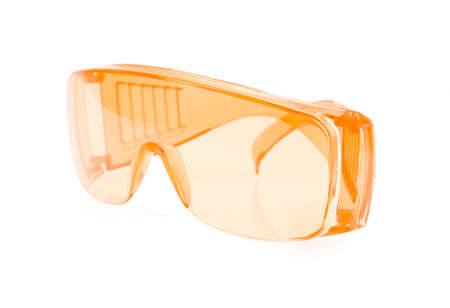 shortsightedness: orange glasses isolated on white background.