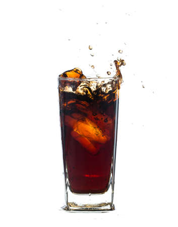 Fresh Coca Cola  with splash isolated on a white background Imagens - 50328385