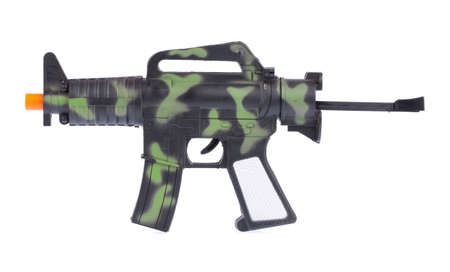 green plastic soldiers: Handgun weapon crime gun toy isolated on white background