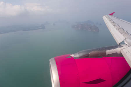 sea scape: Looking through window aircraft during flight in wing with top view