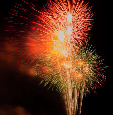 disrupted: Colorful fireworks on the black sky background Stock Photo