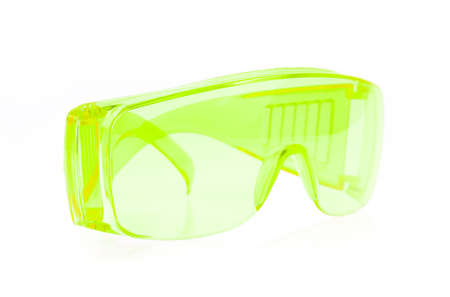 myopic: green glasses isolated on white background. Stock Photo