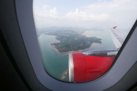 looking through window: Looking through window aircraft during flight in wing with top view