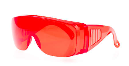 astigmatism: red glasses isolated on white background.