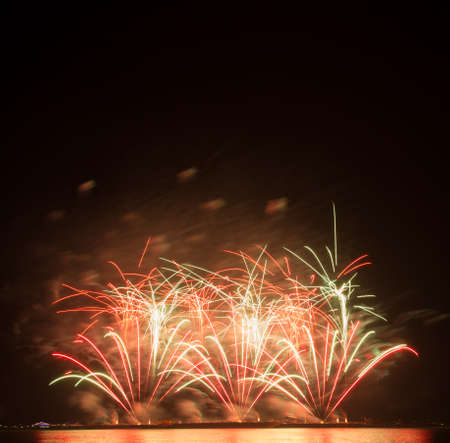 dilate: beautiful of exploding fireworks at night. Represents a celebration. Stock Photo