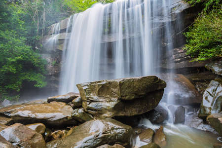 waterfall river: river background with small waterfalls in tropical forest.