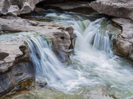 sump: A photography of beautiful waterfall on the rocks