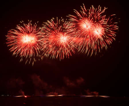 disrupted: beautiful of exploding fireworks at night. Represents a celebration. Stock Photo