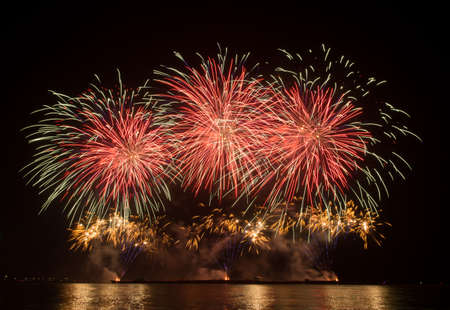 brilliantly: beautiful of exploding fireworks at night. Represents a celebration. Stock Photo