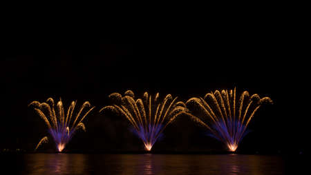 dilate: Colorful fireworks on the black sky background Stock Photo