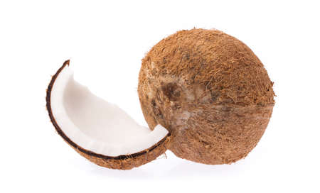 Old brown organic coconut fruit copra broken into pieces and stacked on white background Stock Photo