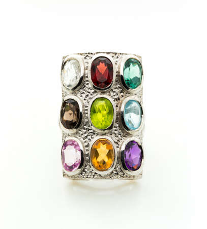 Ring with differet color gemstone on whit background Stock Photo