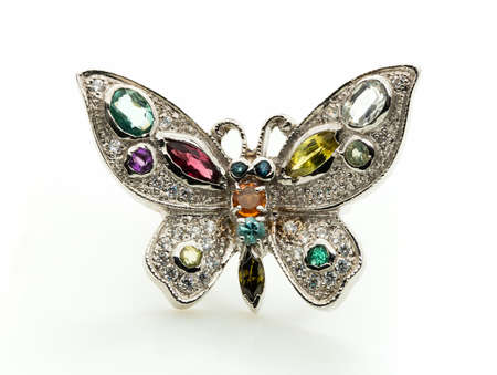 Butterfly Ring with differet color gemstone on whit background