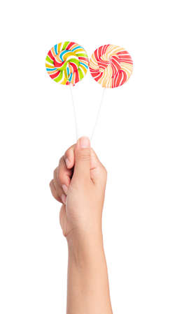 colorfully: hand holding Colorful spiral lollipops isolated on white background