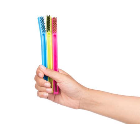 hand holding washing brushes isolated on white background.