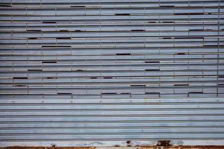 dowdy: grey metal roller door with rust