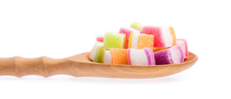 gelatina: colorful jellys on ladle isolated on white background