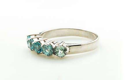 platinum: green emerald band ring on white background Stock Photo