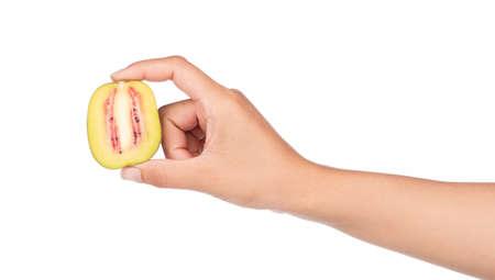 hand holding slice red kiwi fruit isolated on white background Stock Photo