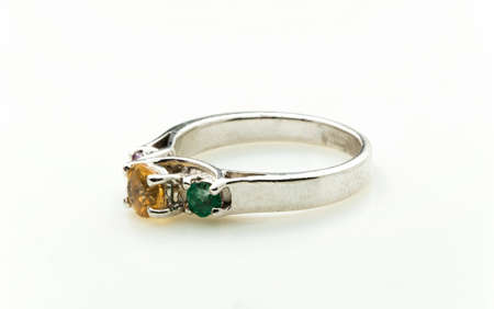 platinum: Ring with differet color gemstone on whit background Stock Photo