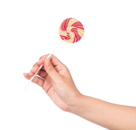 hand holding Colorful spiral lollipop  isolated on white background.