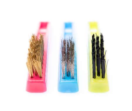 Colour cish washing brushes isolated on white background.