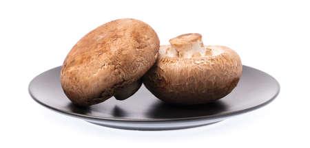 dish of portobello mushrooms, isolated on white background.