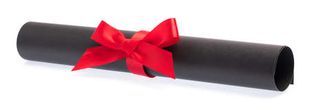 roll black paper with red ribbon isolated on white background