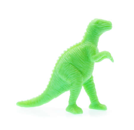 Scary Dinosaur made out of plastic. Dinosaur toy isolated on white background
