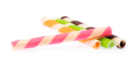 Striped wafer rolls filled isolated on white background