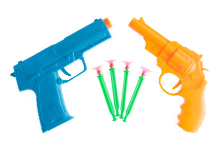 Plastic toy gun with darts isolated on white background Stock Photo