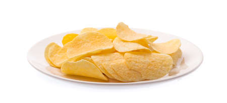 Potato chips on dish isolated on white background