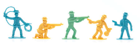 plastic toy cowboys isolated on white background 免版税图像