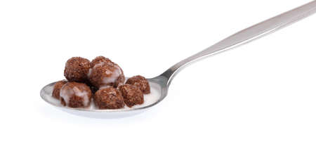 spoon of chocolate Cereal with milk isolated on white background.