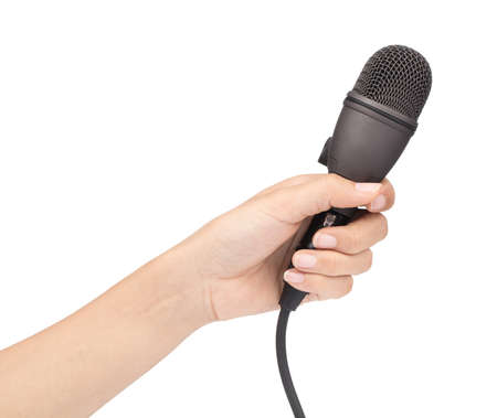 Hand holding a microphone interview conducting a business isolated on white background Stock Photo