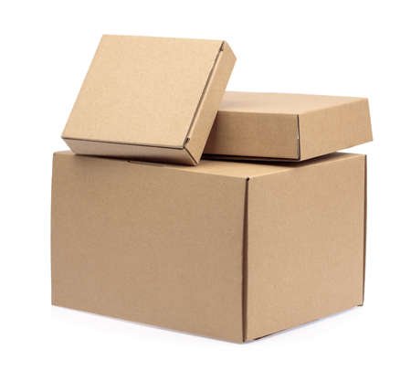 brown paper boxes package stacked isolated on white background