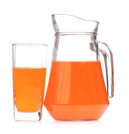 Peach fruit juice in glass jug isolated on a white background Фото со стока - 102431686