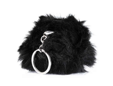 key chain of a pink fur ball isolated on white background