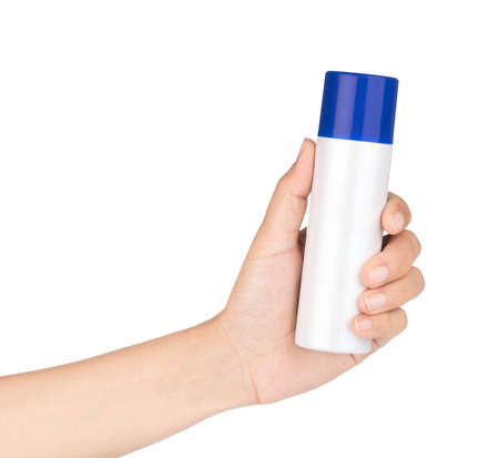 Sunscreen protection can in a female hand, isolated on white background. Banque d'images