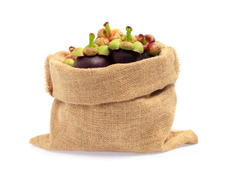 mangosteen fruits in bag burlap isolated on white background Archivio Fotografico