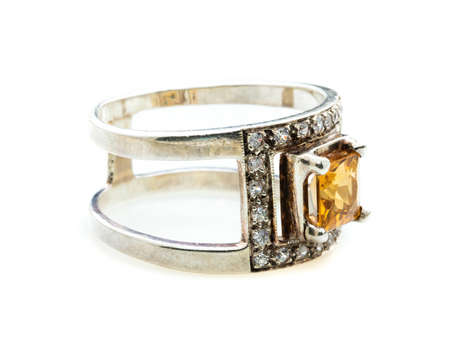 classic ring with a yellow topaz stone on white background Stock Photo