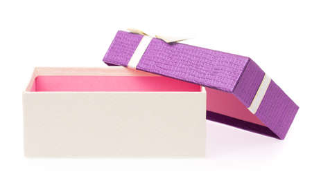 Purple gift box with white ribbon isolated on white background.