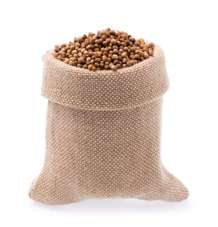 Textile-burlap sack of coriander seeds  isolated on white background Standard-Bild - 104891473
