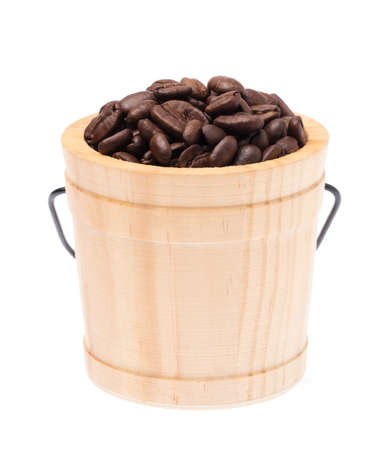 wood cask of roasted coffee beans isolated on white background Фото со стока
