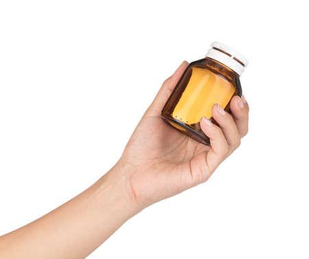 hand holding bottle of medicine isolated on white background