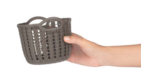 hand holding plastic of basket isolated on a white background