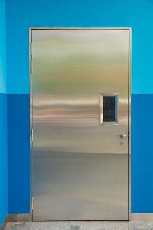 Stainless steel door with blue wall